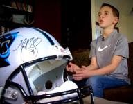 Cade Pope with his autographed Panthers helmet.