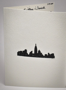 I had a little fun and embossed the front of this card with a city skyline.