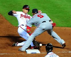 Braves shortstop Andrelton Simmons knocked Yunel Escobar's glove off, and the Nationals third baseman out of the game. . (Photo by Scott Cunningham/Getty Images)