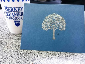 I carefully embossed this silver tree on the card and then dripped ice cream on it. Ooops.