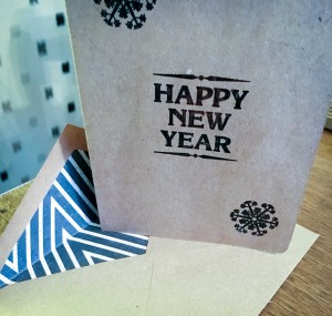 A handmade card and envelope .